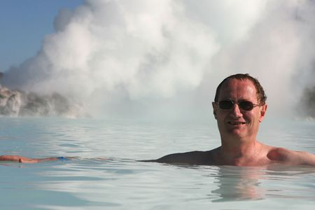 The boiling steam jets heat up an outdoor pool Stock Photo
