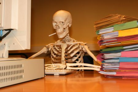 A skeleton types at his word processor