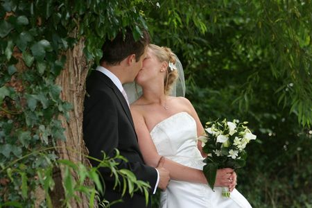 The bride and groom kiss after the wedding