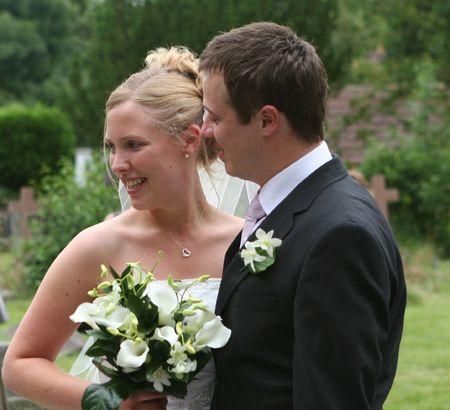 The bride smiles.