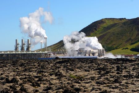 A geothermal power station steams on a cold day in Iceland photo