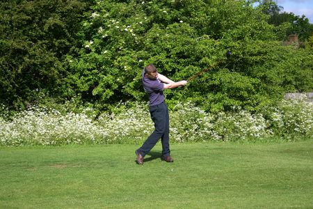A junior golf champion practices his swing