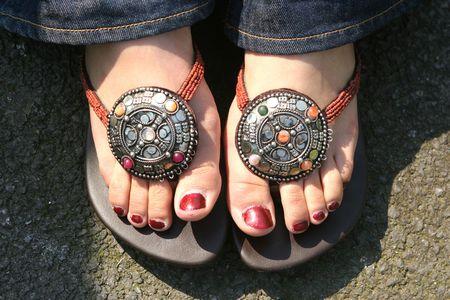 Feet in the summer sunshine Stock Photo