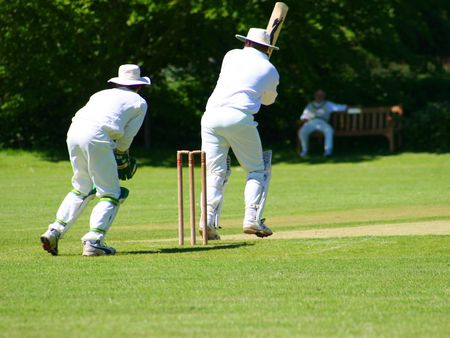Two local cricket teams on a village green