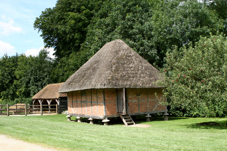 A timber framed granary from 1731 standing on staddle stones to stop rats getting to the grain