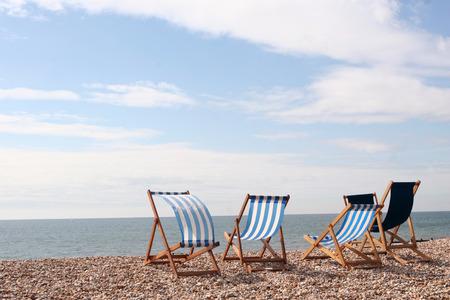 Empty deckchairs on the beach at Bognor Regis Sussex England Stock Photo