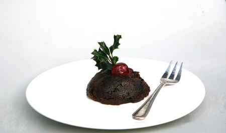 A delicious cherry sits on a Christmas Pudding Stock Photo - 2171219
