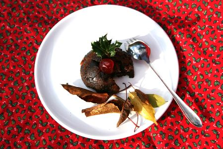 A delicious cherry sits on a Christmas Pudding Stock Photo - 2171223