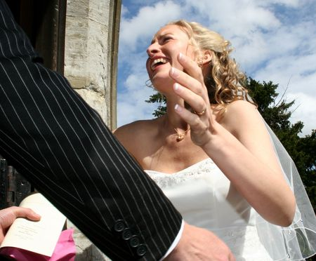 A happy bride embaces her new husband Stock Photo - 2479519