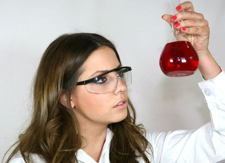 analyses: A student analyses a red solution