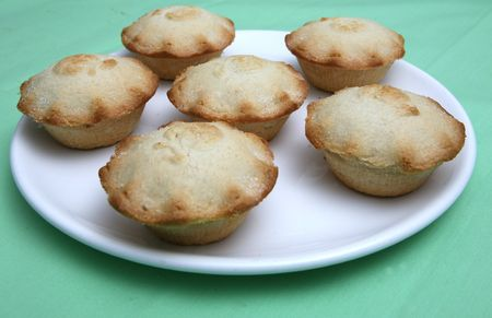 A Plate of individual apple pies
