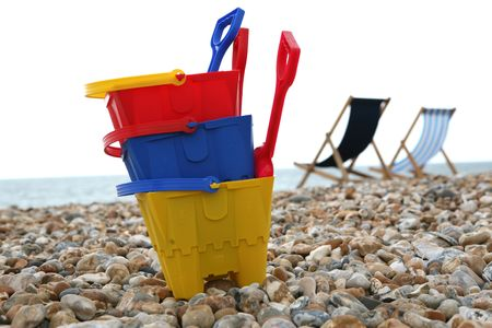 A Childs buckets and spades on the pebble beach at Bognor Regis Sussex