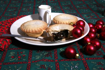 A tasty display of festive Christmas mince pies on a plate photo
