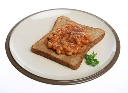 A simple snack of Beans on Toast isolated. Stock Photo