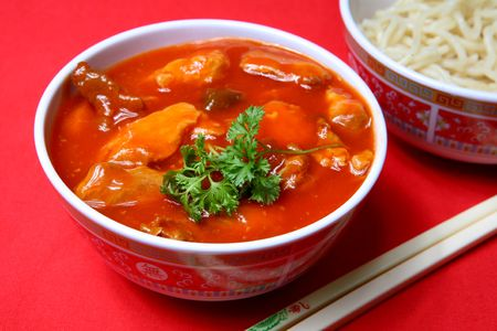 A tasty meal of sweet and sour pork with rice Stock Photo