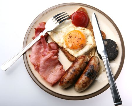 A tasty plate of fried food for breakfast, isolated Stock Photo - 6996356