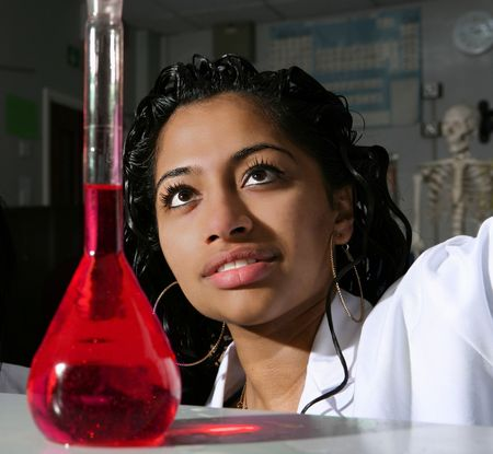 A student prepares a solution of yellow food colouring Stock Photo