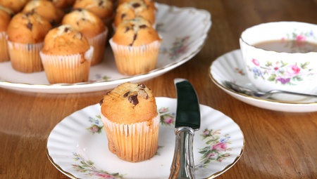 Afternoon tea in England with chocolate muffins and a nice cup of tea Stock Photo - 10827165
