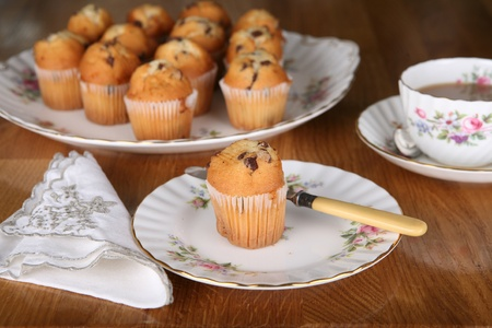 Afternoon tea in England with chocolate muffins and a nice cup of tea Stock Photo - 10827186