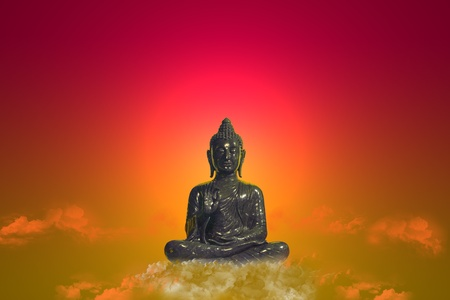 Buddha seated on a cloud Stock Photo