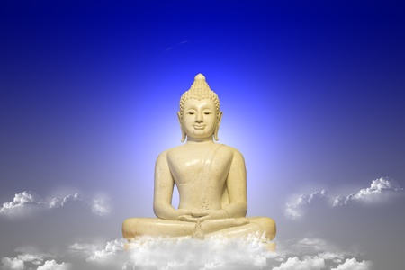 White Buddha seated on a cloud. Stock Photo