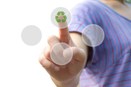 woman hand pressing recycle icon