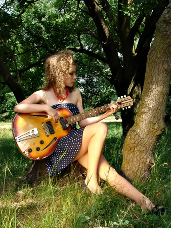 Girl on the picnic with guitar photo