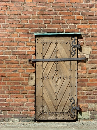 Old wooden handcuffed doors photo