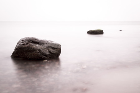 Rock in the water photo