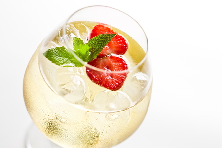 Refreshing summer white sparkling wine drink close up soft focus on a white background