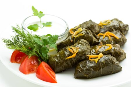Traditional georgian dolma in grape leaves close up. Stuffed grape leaves with rice and meat