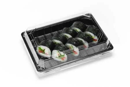 Traditional Sushi roll with salmon, nori and vegetables in a plastic container box for take away