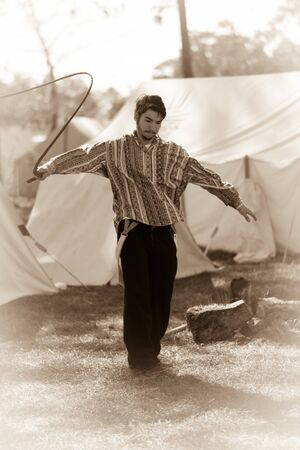 Man cracking a whip in the southern camp. Editorial