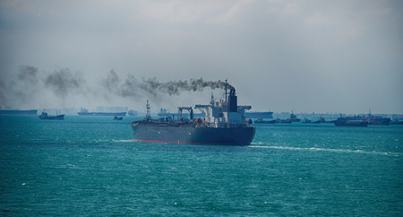 Black Smoke from Ship Sailing on the High Sea