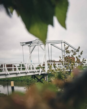 Old tradidional bridge in Germany framend in green leaves Stock fotó