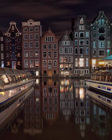 Damrak canal in Amsterdam by night