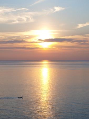 Wonderful sunset at the sea - location: Phromthep Cape, Phuket province, Thailand. photo