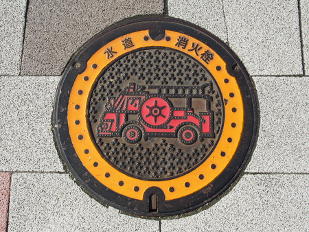 Manhole drain cover on the street at Tokyo, Japan photo