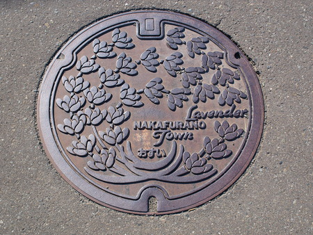 Manhole drain cover on the street at Furano, Hokkaido - Japan photo