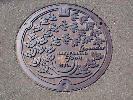 Manhole drain cover on the street at Furano, Hokkaido - Japan photo