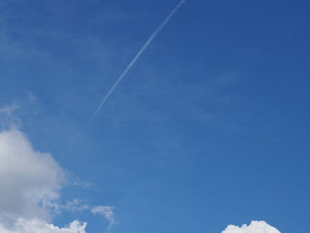 contrail: clouds on the blue sky and the contrail Stock Photo