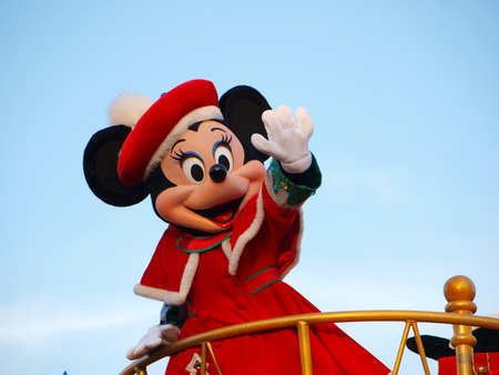 Minnie Mouse in the red coat waving her hand in daytime Parade on December 14, 2012 at Tokyo-Disneyland, Tokyo, Japan. Editöryel