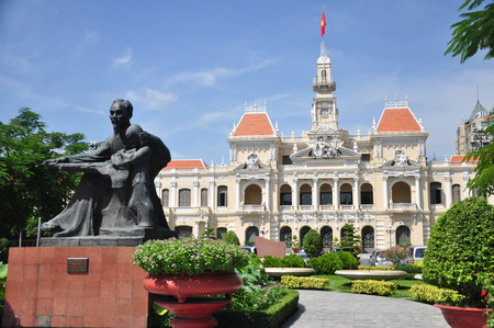 committee: Statue of Ho Chi Minh and People s Committee Building in Ho Chi Minh City, Vietnam.