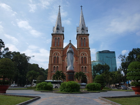 famous building: HO CHI MINH CITY, VIETNAM - NOVEMBER 29: Notre-Dame Cathedral landmark in Ho Chi Minh City, Vietnam on November 29, 2013. The cathedral is a very famous building in HCMC.