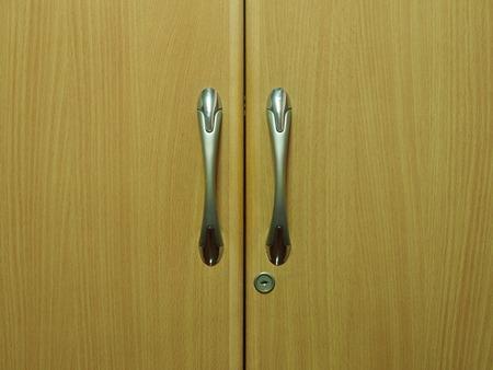 wooden oak wardrobe door two handles closeup photo
