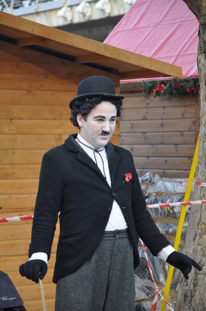 chaplin: LONDON, UK - NOVEMBER 12, 2011: An unidentified artist dressed up as Charlie Chaplin on the street in London, United Kingdom.