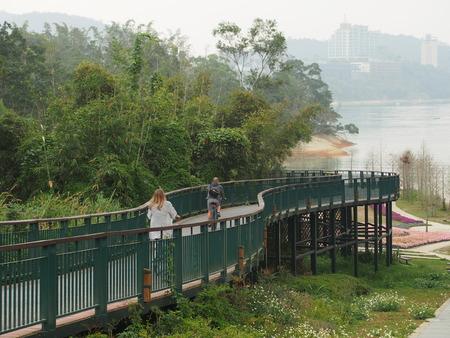 Two cyclist on bike trail around Sun Moon Lake in Nantou, Taiwan. Stock Photo
