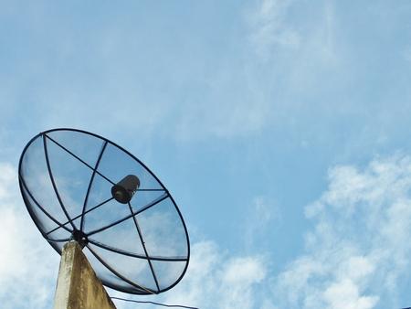 sattelite: Satellite dish on the blue sky.