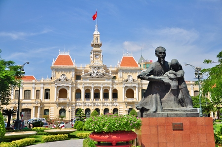 Statue of Ho Chi Minh and Peoples Committee Building in Ho Chi Minh City, Vietnam.