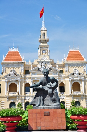 committee: Statue of Ho Chi Minh and Peoples Committee Building in Ho Chi Minh City, Vietnam.